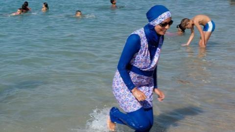UN rights office calls on French towns to lift burkini bans