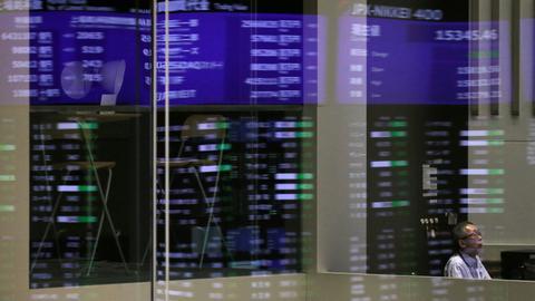 Asian shares on edge, trim gains as US futures slip