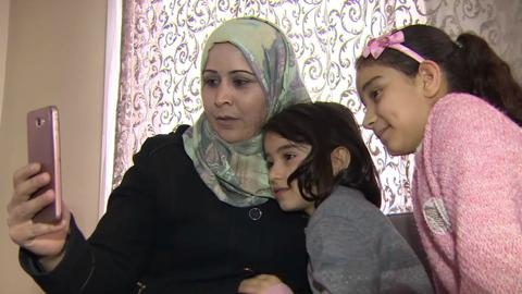 Syrian refugees in Turkey struggle to stay in touch with families back home