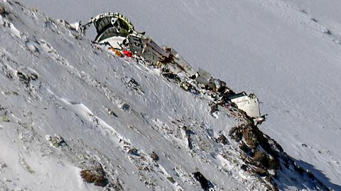 Emergency teams carry dead from mountain plane crash site in Iran