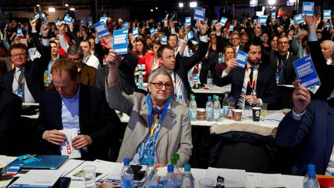 German Chancellor Merkel's party votes in favour of coalition deal