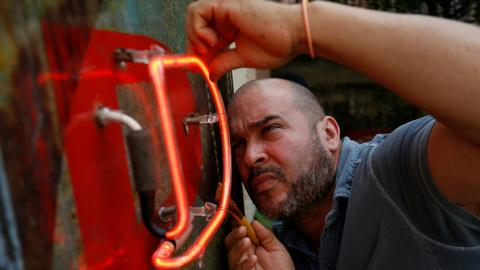 Cuban artist switches Havana's neon lights back on