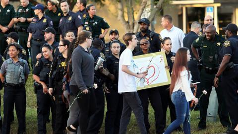 Florida high school gingerly resume classes after gun massacre