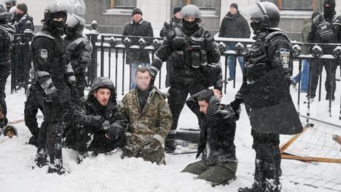 Ten injured in clashes as police break up protest camp in Ukraine