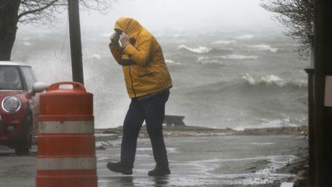Killer storm exits US Northeast, leaving floods, outages
