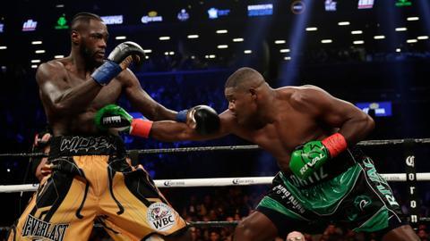Wilder survives pummeling to stop Ortiz in 10th