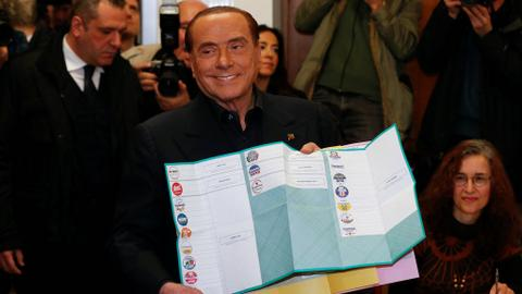 Exit polls show Italy's Berlusconi ahead in votes but no majority
