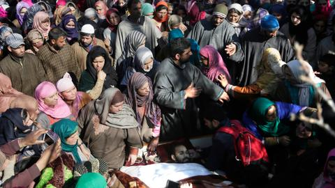 Kashmir under curfew and strikes as Indian troops kill six people