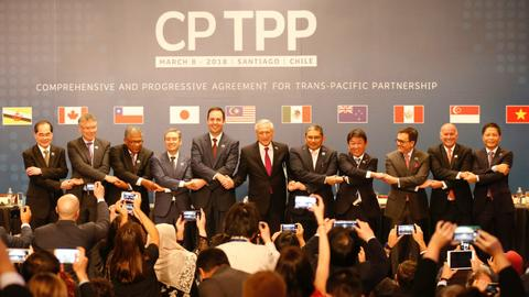 Eleven nations sign Pacific trade pact as Trump plans US tariffs