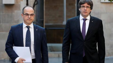Catalan presidency candidate arrives at parliament amid opposition outrage