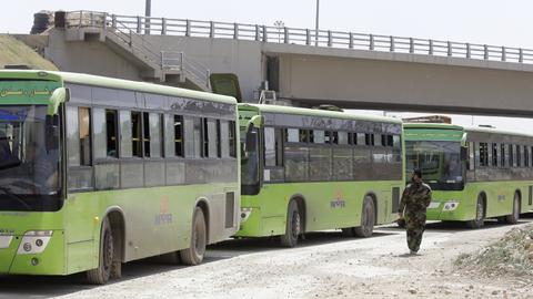 Syrian rebels, civilians exit second pocket of Syria's eastern Ghouta