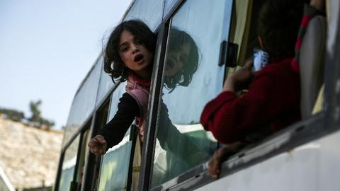 Biggest convoy yet evacuates Syria's ruined eastern Ghouta