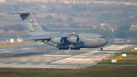 What is the legal status of the US air bases in Turkey and Qatar?