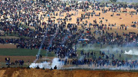 Israeli troops kill at least 16 Palestinians during Land Day protests