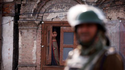 Kashmir shuts down over killings of civilians and rebels