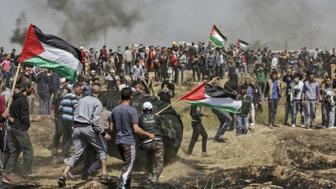 At least 10 Palestinians killed and scores wounded on Gaza border