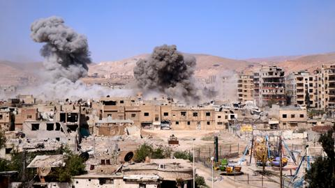 Regime air strikes in Syria's Ghouta kill at least 50 as talks sputter