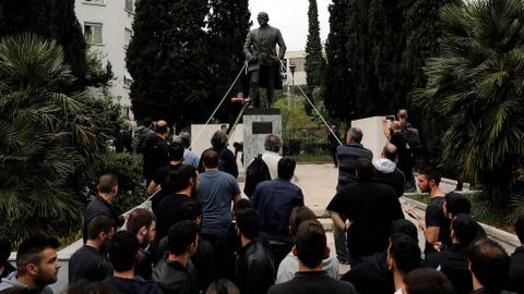 Greek protesters in Athens try to bring down Truman statue