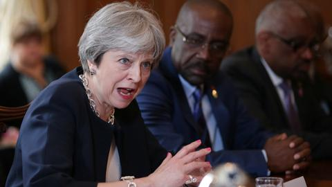 Britain's May apologises to Caribbean leaders over immigration mix-up