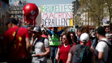 France's Macron faces mass protests as opponents join forces