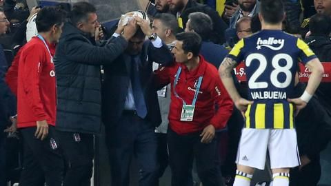 Turkish football game abandoned after Besiktas coach hit by object
