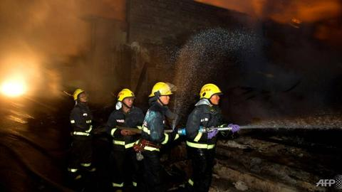China captures arson suspect in karaoke lounge blaze that killed 18
