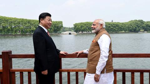 China's Xi and India's Modi agree to reduce border tensions