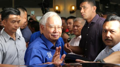 Malaysian Prime Minister Najib Razak admits defeat in historic election