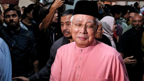 Defeated Malaysian leader resigns from his party