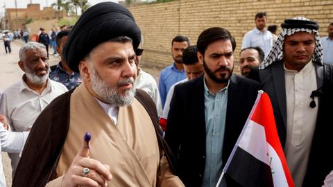 Fiery cleric and a paramilitary boss lead Iraqi election race
