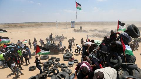 Palestinians bury their dead while marking 'Nakba Day'