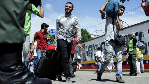 Unconvinced by the election, Venezuela emigres stream across border