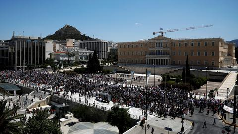 Greek workers strike against bailout reforms