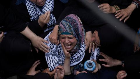 Thousands attend funeral of Gaza paramedic shot by Israeli forces