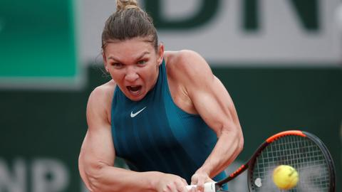 Halep triumphs over Kerber at Roland Garros