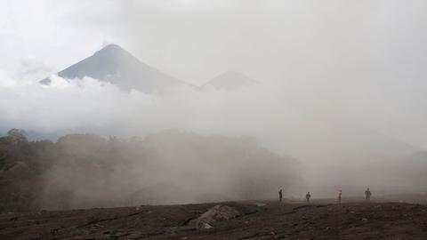 Guatemalans bury dead after volcano eruption