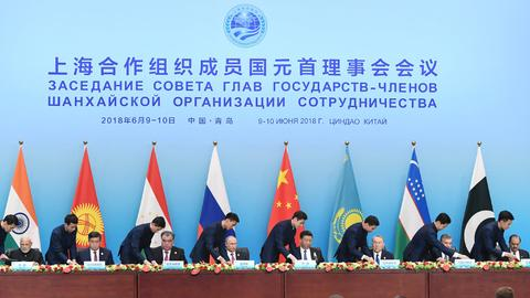 Xi extolls free trade at SCO meet as G7 ends in disarray