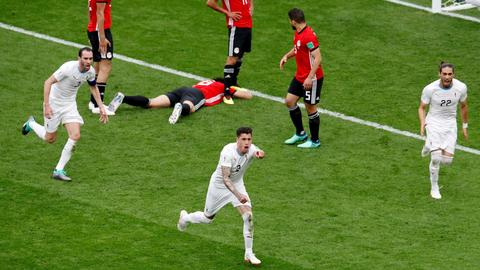 Uruguay, Iran win their World Cup matches