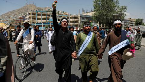 Afghan peace marchers arrive in Kabul as Taliban end ceasefire