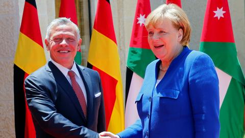 Merkel promises $100 million loan for troubled Jordan