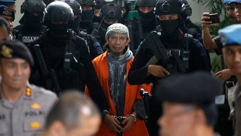 Indonesia court sentences cleric behind terror attacks to death