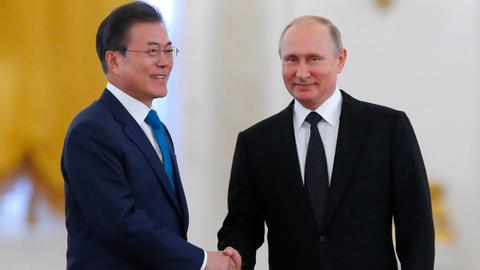 Moon, Putin meet in Russia, hope to boost economic ties