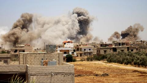 Air strikes kill five as southern Syria assault looms