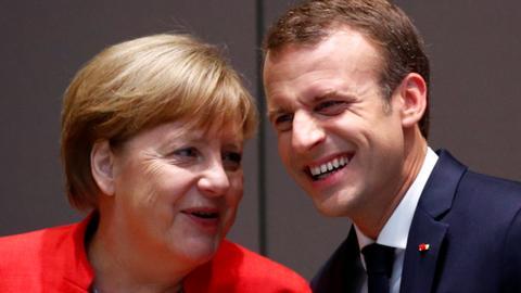 Embattled Merkel draws up new measures to tackle migration