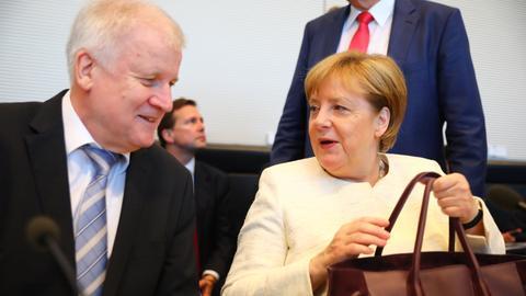 Merkel's migrant deal hangs on Social Democrat, EU approval