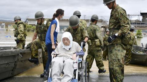 'Race against time' to save Japan flood victims as death toll climbs to 76