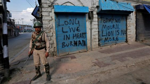 Curfew, protests as Kashmir shuts down on rebel's death anniversary
