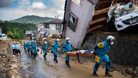 Japan prime minister says death toll from floods tops 100