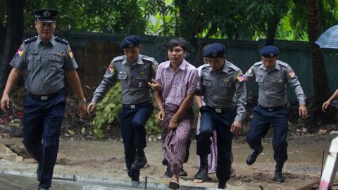Reuters reporters to face trial in Myanmar