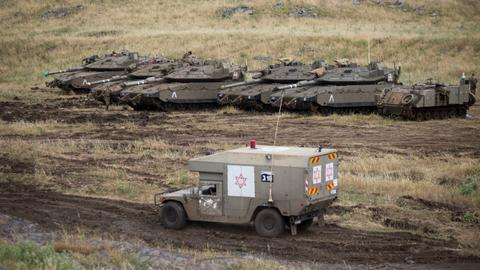Israel hits Syrian army posts after drone incursion